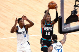 <strong>Memphis Grizzlies guard Ja Morant (12) shoots between Dallas Mavericks guard Josh Richardson (0) and center Willie Cauley-Stein (33) during the Grizzlies 133-104 win Tuesday, May 11, 2021, in Memphis.</strong> (AP Photo/Wade Payne)