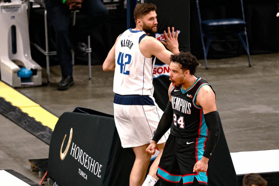 <strong>Memphis Grizzlies forward Dillon Brooks (24) reacts after a dunk next to Dallas Mavericks forward Maxi Kleber (42) during the second half of an NBA basketball game Tuesday, May 11, 2021, in Memphis.</strong> (AP Photo/Wade Payne)