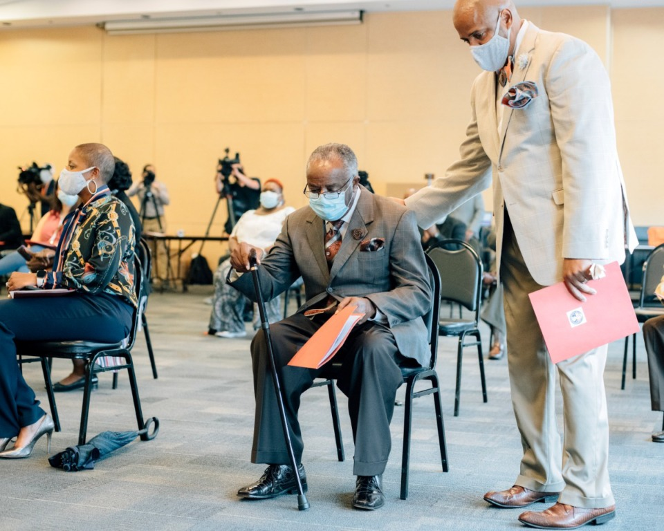 <strong>Pastor Carl Payne (center), the father of Pervis Payne, is helped to his seat by his son-in-law Dr. Cary Holman during an August 2020 press conference urging Shelby County District Attorney Amy Weirich&nbsp;to test DNA in Pervis Payne&rsquo;s 1987 murder case. Payne has maintained his innocence for 33 years</strong>. (Houston Cofield/Special to The Daily Memphian file)