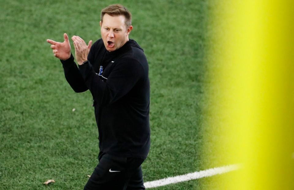 <strong>Memphis head coach Ryan Silverfield encourages his players during spring football practice on Tuesday, March 23.</strong> (Mark Weber/Daily Memphian file)
