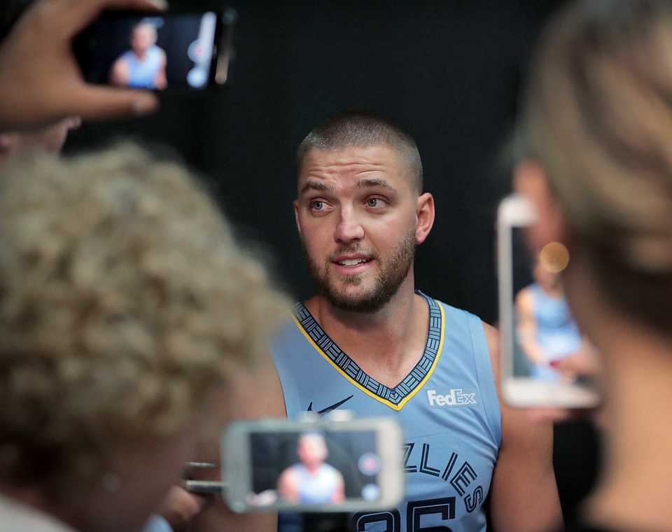 <strong>Chandler Parsons fields questions by a crowd of phone wielding reporters during the annual Grizzlies media day at the FedExForum on Sept. 24, 2018.</strong> (Jim Weber/Daily Memphian)