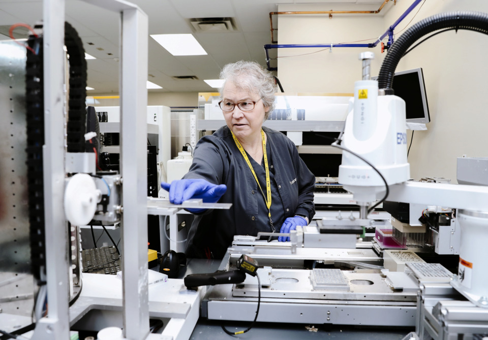 <strong>Pam Tisdale, a lab technician at Transnetyx, adds chemicals to samples to extract purified DNA for gene testing. The Memphis-based genetic services company recently processed its 20 millionth sample.</strong> (Houston Cofield/Daily Memphian)