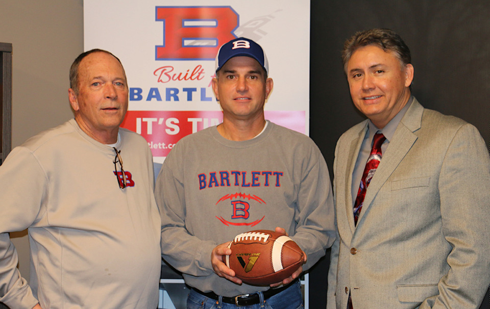 <strong>Lance Tucker (center) is Bartlett's new football coach. He's pictured here with school principal Tim Jones (right) and system athletic director Phil Clark. </strong>(Submitted)