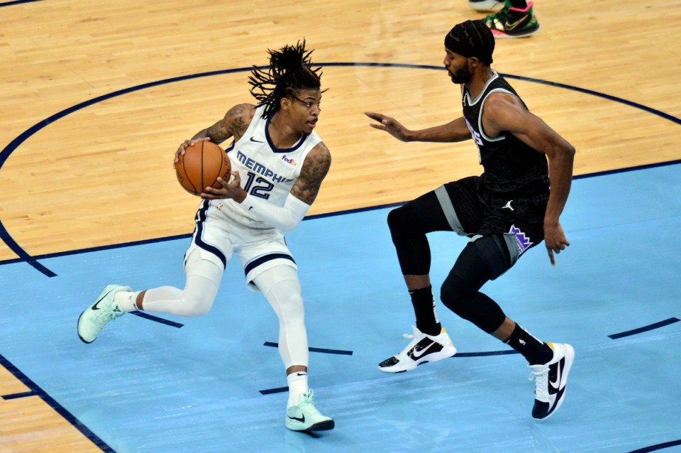<strong>Memphis Grizzlies guard Ja Morant (12) handles the ball against Sacramento Kings forward Maurice Harkless in the first half of an NBA basketball game Thursday, May 13, 2021, at FedExForum.</strong> (Brandon Dill/AP)