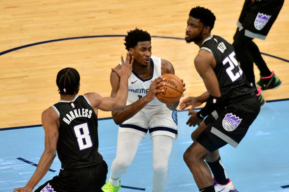 <strong>Memphis Grizzlies forward Jaren Jackson Jr. handles the ball between Sacramento Kings forward Maurice Harkless (8) and Sacramento Kings forward Chimezie Metu (25) in the first half of an NBA basketball game Thursday, May 13, 2021, at FedExForum.</strong> (Brandon Dill/AP)