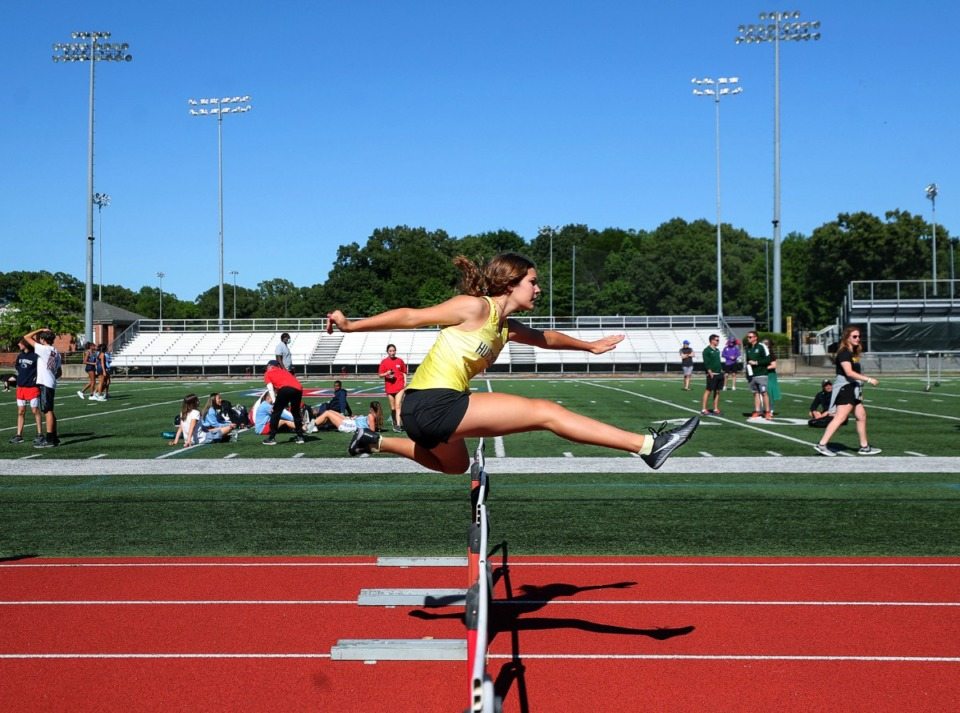<strong>Hutchison's Addison Magee clears a hurdle during the women's 100 meter hurdles at Memphis University School May 13, 2021.</strong> (Patrick Lantrip/Daily Memphian)