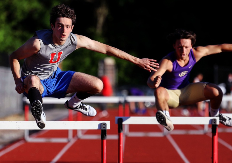 <strong>MUS' Lee Couloubaritis (left) competes in the men's 300 meter hurdles at Memphis University School May 13, 2021.</strong> (Patrick Lantrip/Daily Memphian)