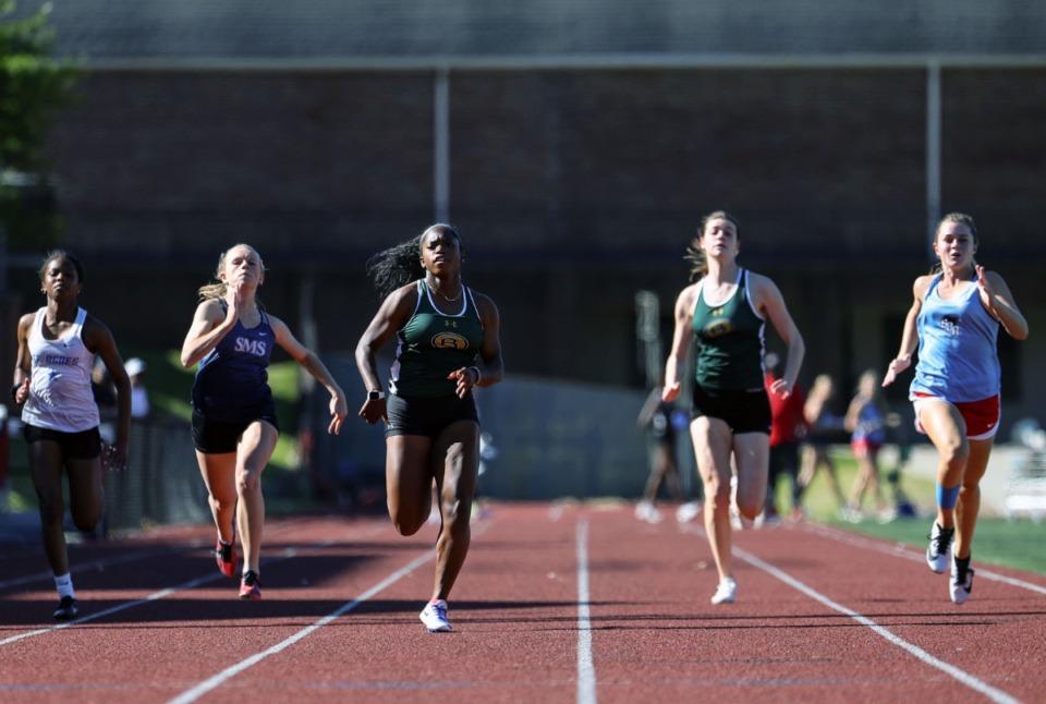 <strong>Briarcrest's Dalis Hawkins (center) wins the women's 100 meter dash at Memphis University School May 13, 2021.</strong> (Patrick Lantrip/Daily Memphian)