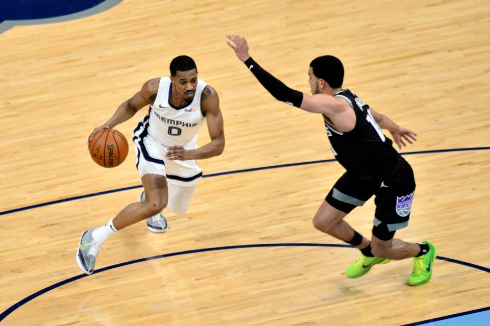 <strong>Memphis Grizzlies guard De'Anthony Melton (0) handles the ball against Sacramento Kings guard Justin James (10) in the first half of an NBA basketball game Thursday, May 13, 2021, in at FedExForum.</strong> (Brandon Dill/AP)