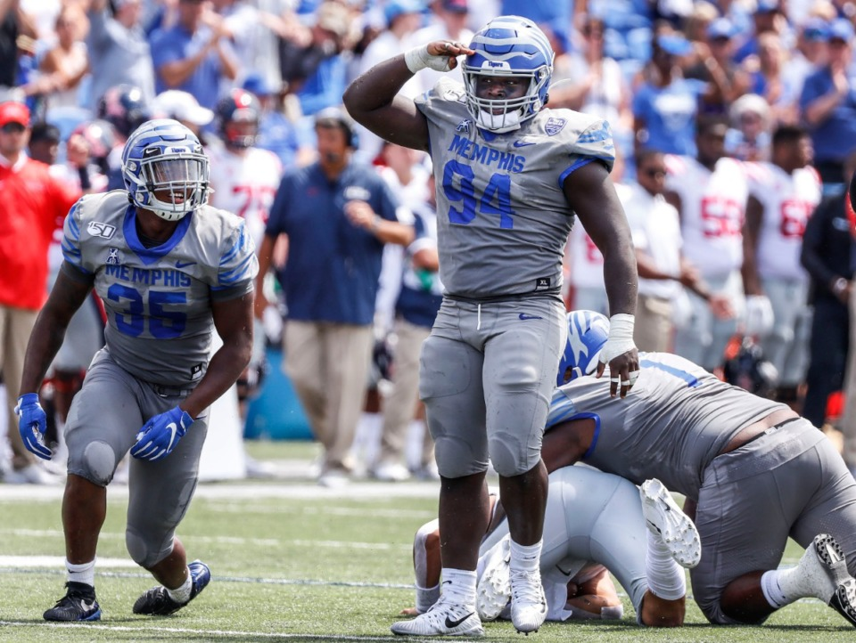 <strong>Memphis defensive linemen Joseph Dorceus (middle) celebrates an Ole Miss tackle during action in their NCAA football game at the Liberty Bowl Memorial Stadium Saturday, Aug. 31, 2019.</strong> (Mark Weber/Daily Memphian)