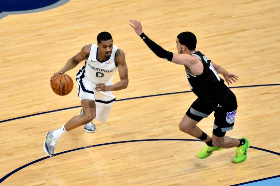 <strong>Memphis Grizzlies guard De'Anthony Melton (0) handles the ball against Sacramento Kings guard Justin James (10) in the first half of an NBA basketball game Thursday, May 13, 2021, at FedExForum.</strong> (Brandon Dill/AP)