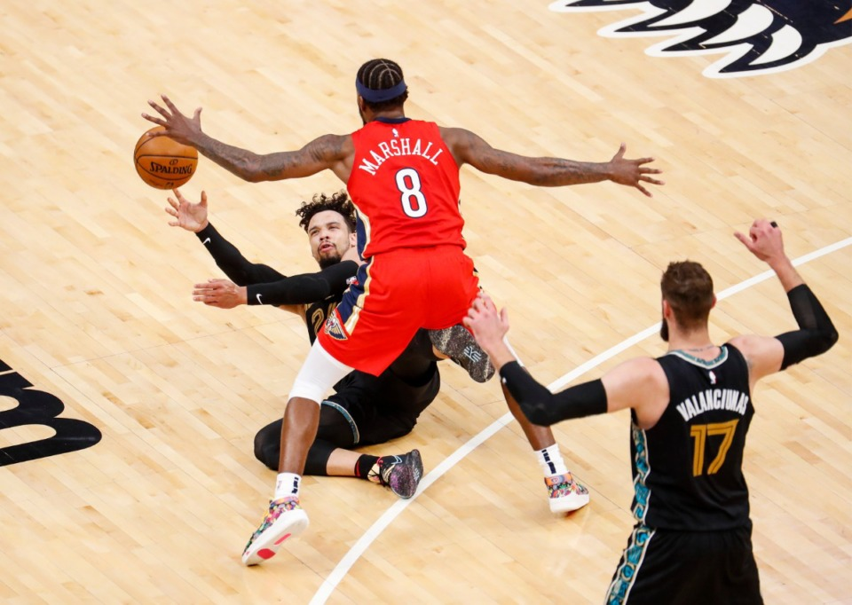<strong>Memphis Grizzlies guard Dillon Brooks (left) makes a pass from the floor to teammate Jonas Valanciunas (right) around New Orleans Pelicans defender Naji Marshall (middle) during action on Monday, May 10, 2021.</strong> (Mark Weber/The Daily Memphian)
