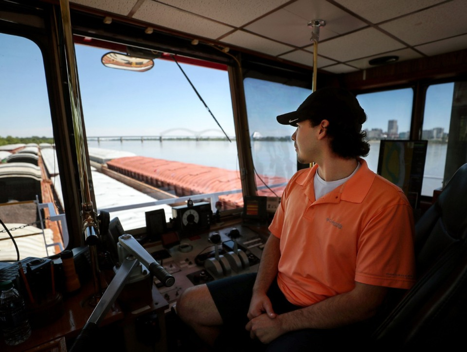 <strong>Justin Santoro looks to the Hernando DeSoto Bridge as he awaits permission to continue steering his barge south on the Mississippi River May 14, 2021.</strong> (Patrick Lantrip/Daily Memphian)