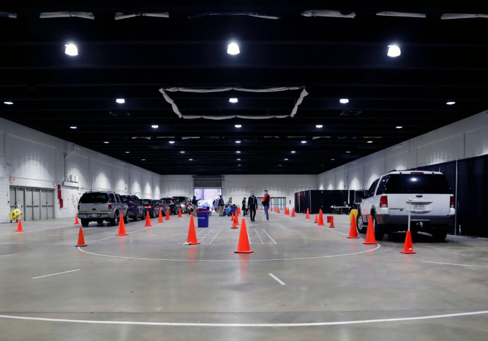 <strong>Cars line up at the Shelby County Health Department's COVID-19 vaccination site at the Pipkin Building Feb. 2, 2021.</strong> (Patrick Lantrip/Daily Memphian file)