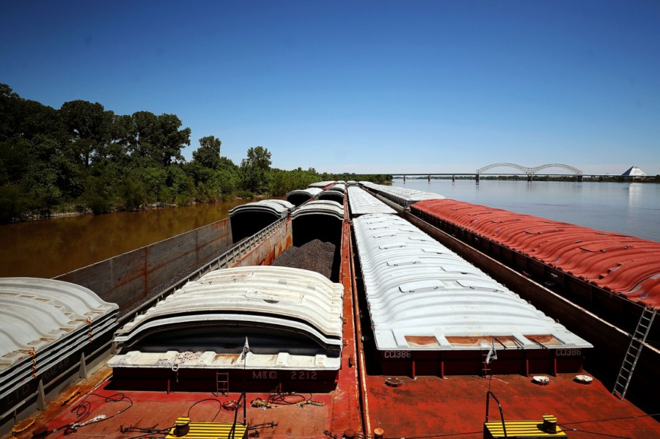<strong>A barge carrying iron ingots has been waiting for clearance to continue traveling under the Hernando DeSoto Bridge May 14, 2021.</strong> (Patrick Lantrip/Daily Memphian)
