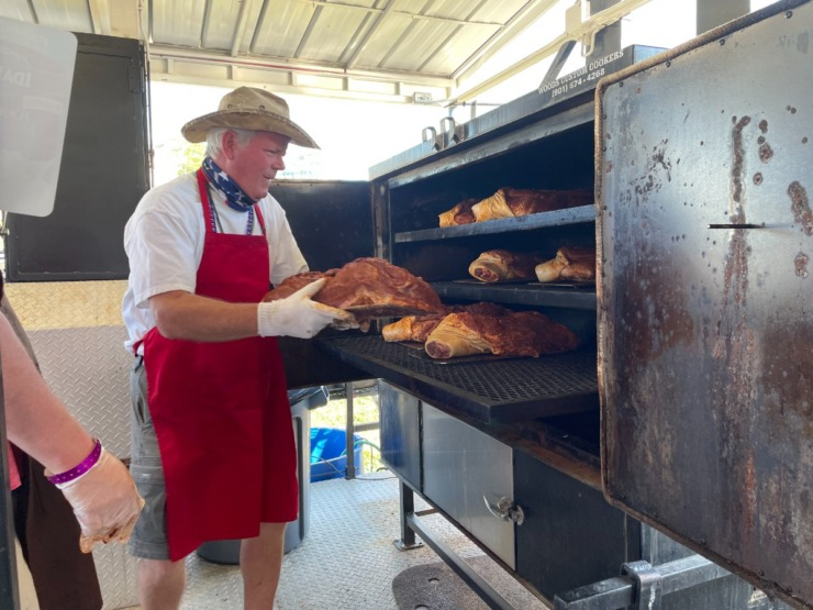 <strong>Mike Quinn puts shoulders in the smoker at Hog Wild-Competition Team. Nine are being cooked overnight for Saturday&rsquo;s competition.</strong> (Jennifer Biggs/Daily Memphian)