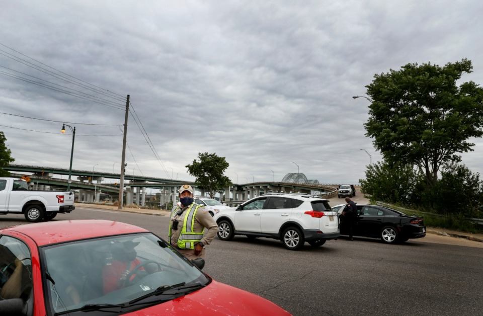 <strong>Memphis Police direct cars away from the I-40 bridge entrance on Tuesday, May 11, 2021. The bridge remains closed to all traffic after a crack was discovered during a routine inspection.</strong> (Mark Weber/The Daily Memphian)