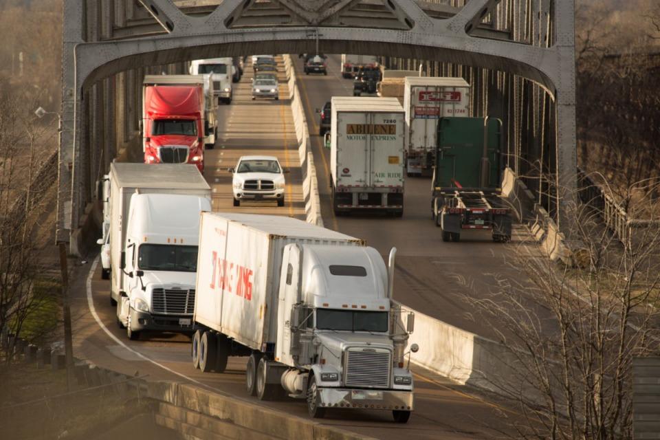 <strong>Trucks rumble across the Memphis-Arkansas Bridge. (Daily Memphian file)</strong>
