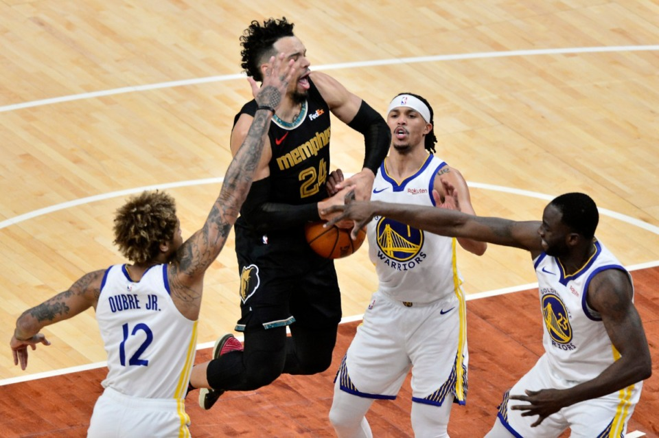 <strong>Memphis Grizzlies forward Dillon Brooks (24) handles the ball against Golden State Warriors guards Kelly Oubre Jr. (12) and Damion Lee (1), and forward Draymond Green (23) in the first half of an NBA basketball game Friday, March 19, 2021, at FedExForum.</strong> (Brandon Dill/AP file)