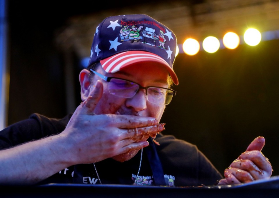 <strong>A contestant competes in the Rib Rumble rib eating contest.</strong> (Patrick Lantrip/Daily Memphian)