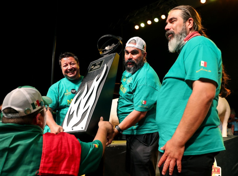 <strong>Members of Mexican BBQ Team celebrate after winning second place in the shoulder category.</strong> (Patrick Lantrip/Daily Memphian)