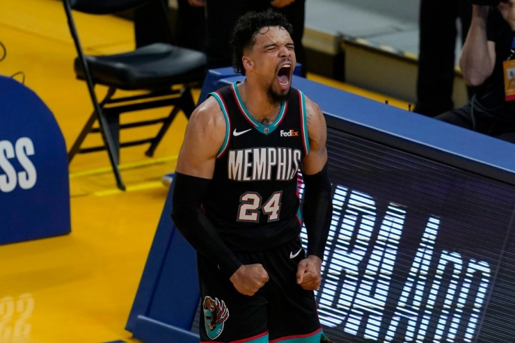 Memphis Grizzlies forward Dillon Brooks (24) reacts after scoring against the Golden State Warriors during the second half of an NBA basketball game in San Francisco, Sunday, May 16, 2021. (AP Photo/Jeff Chiu)