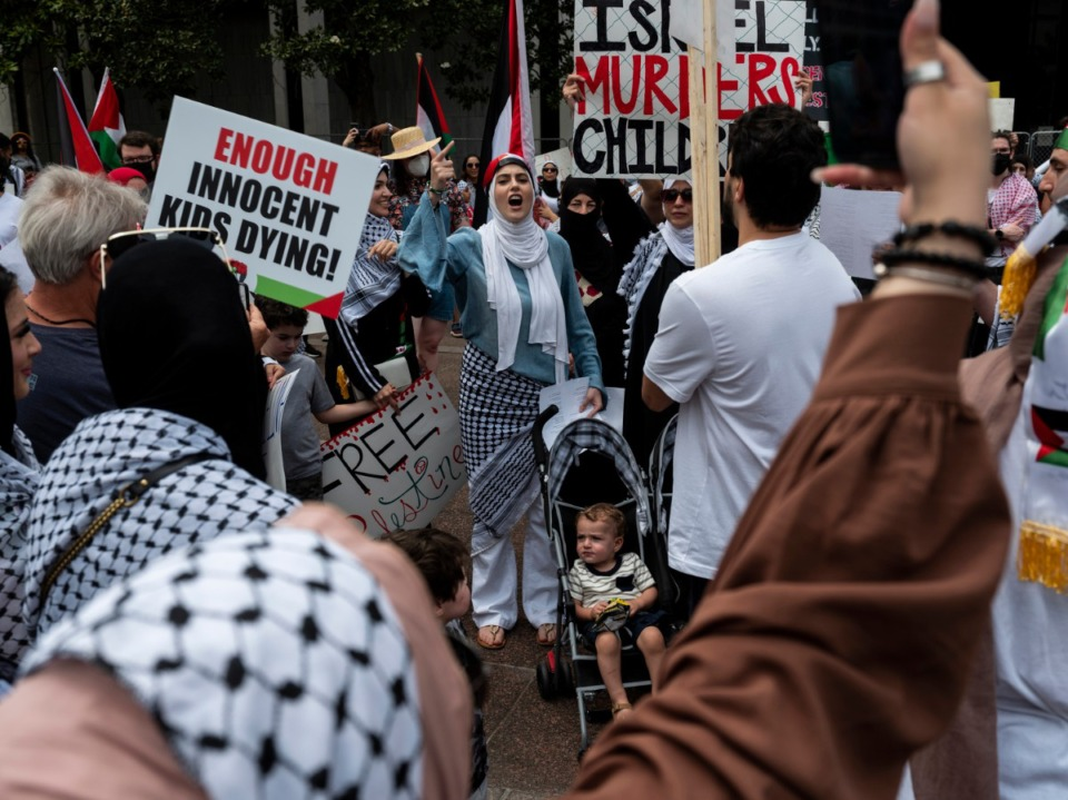<strong>Dalia Ayesh leads a chant during a rally and march in support of Palestine that went from Memphis City Hall to the National Civil Rights Museum and back Sunday, May 16, 2021.</strong> (Brad Vest/Special to The Daily Memphian)