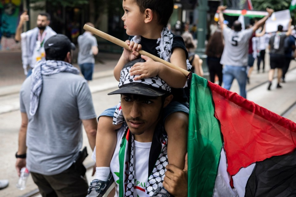 <strong>Imad Hazama holds his nephew, Hassan Hazama, 2, on his shoulders during the march in support of Palestine that went from Memphis City Hall to the National Civil Rights Museum and back.</strong> (Brad Vest/Special to The Daily Memphian)