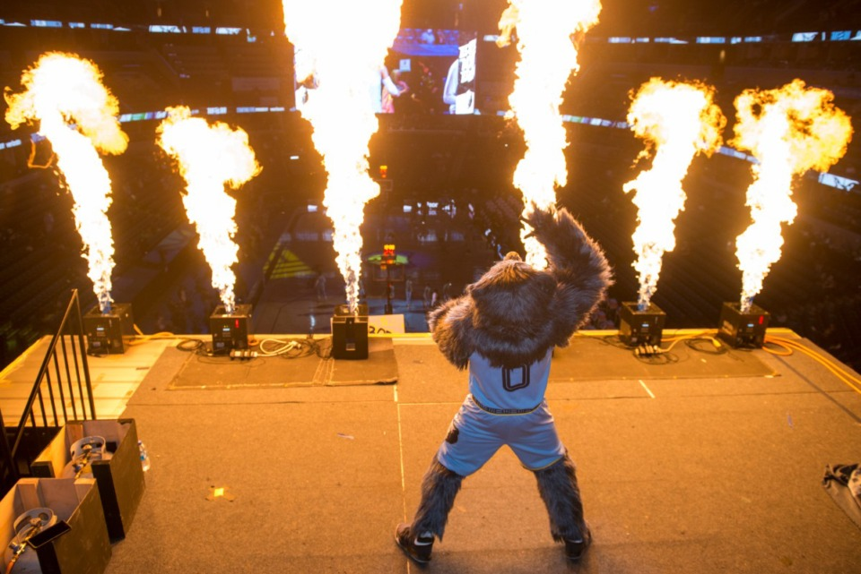 <strong>The Memphis Grizzlies mascot Grizz stands in front of a pyrotechnics display before an NBA basketball game at FedExForum.</strong> (Brandon Dill/AP file)