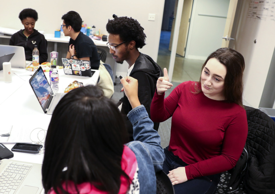 <strong>Devin Dearmore (right) and Mallori King work on a handshake during a planning session for an open mic night hosted by Memphis Against Sexual Harassment and Assault. The event will be held 3-5 p.m. Saturday, Jan. 26, at Bridges USA.</strong> (Houston Cofield/Daily Memphian)