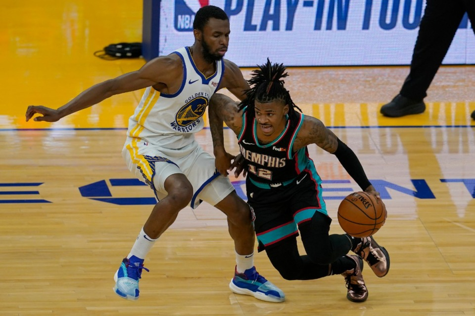 <strong>Memphis Grizzlies guard Ja Morant is defended by Golden State Warriors forward Andrew Wiggins during the first half of their game in San Francisco on Sunday, May 16.</strong> (Jeff Chiu/Associated Press)