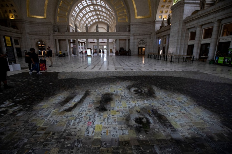 <strong>A 1,000-square foot mosaic of Ida B. Wells adorns the floor at Washington's Union Station, Saturday, Aug. 29, 2020, greeting visitors and traveler with the artwork, installed in honor of the 100th anniversary of women's right to vote. The mosaic celebrates the pioneering civil rights leader and journalist.</strong> (AP Photo/Manuel Balce Ceneta)