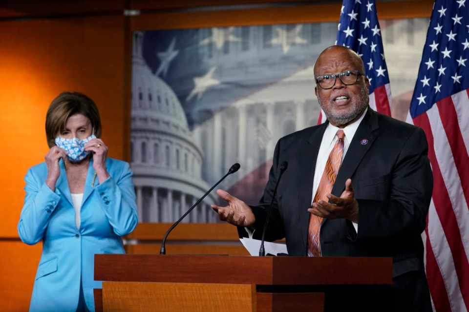 <strong>Rep. Benny Thompson, D-Mississippi (right), talks to reporters about the proposed independent, bipartisan commission to investigate the Jan. 6 attack on the United States Capitol complex, a proposal that passed the U.S. House of Representatives May 19. House Speaker Nancy Pelosi of California stands at left.</strong> (Susan Walsh/AP)