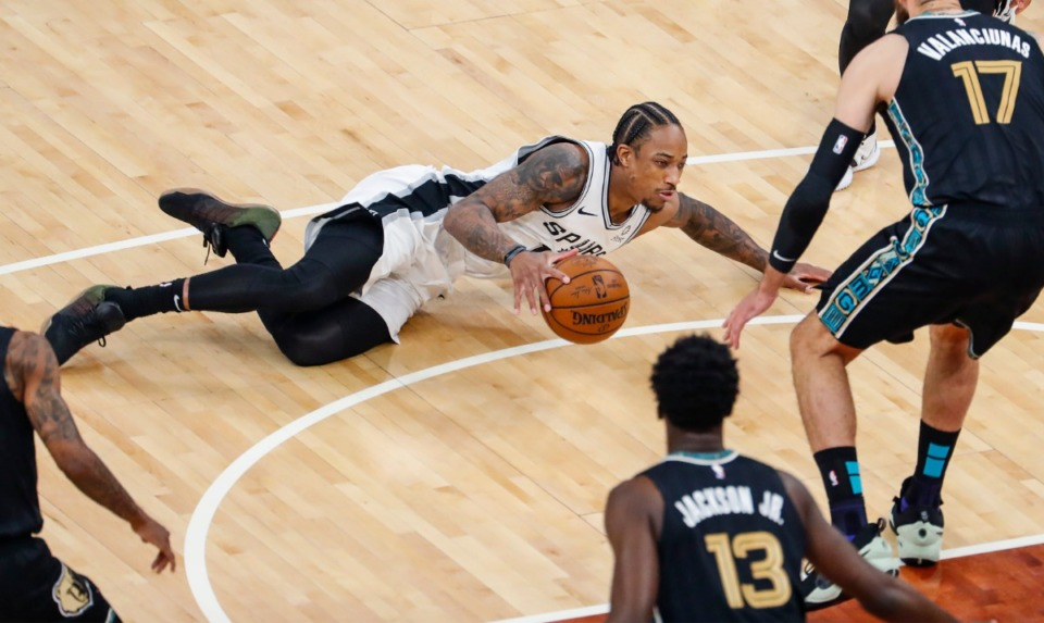 <strong>San Antonio Spurs guard DeMar DeRozan (middle) loses the ball after falling in the game against the Grizzlies on May 19 at FedExForum.</strong> (Mark Weber/The Daily Memphian)