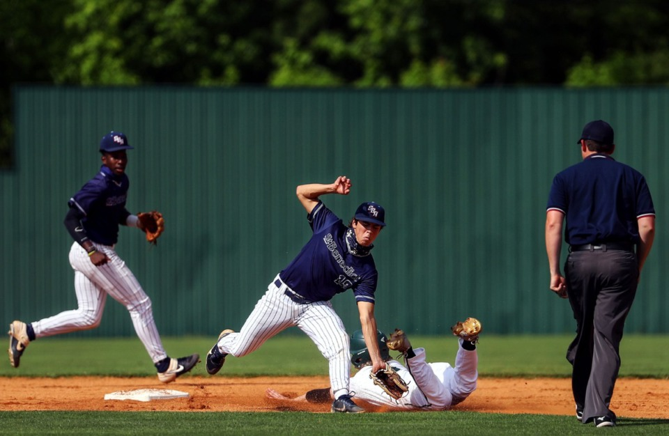 <strong>St. Benedict&rsquo;s second baseman Seamus Carrusco (12) tries to tag a Briarcrest runner on May 19.</strong> (Patrick Lantrip/Daily Memphian)