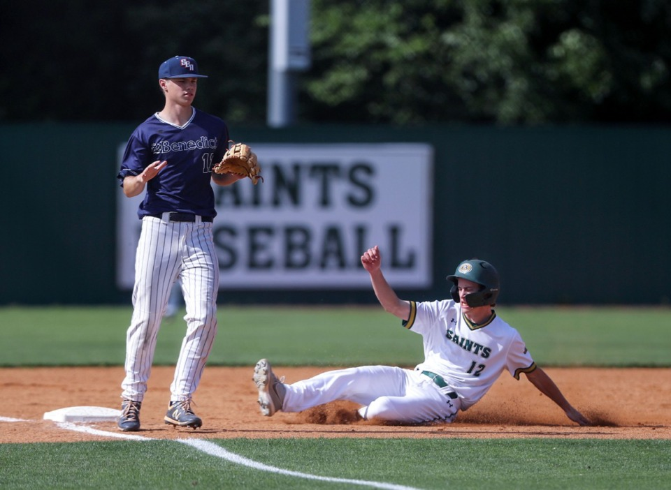 <strong>Briarcrest pinch runner Joshua Brown (12) steals third on May 19 in the game against St. Benedict.</strong> (Patrick Lantrip/Daily Memphian)