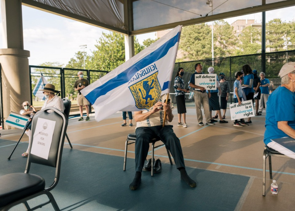 <strong>A rally attendee waves an Israeli flag in support of Israel at the Memphis Jewish Community Center on May 19.</strong> (Houston Cofield/Special to The Daily Memphian)