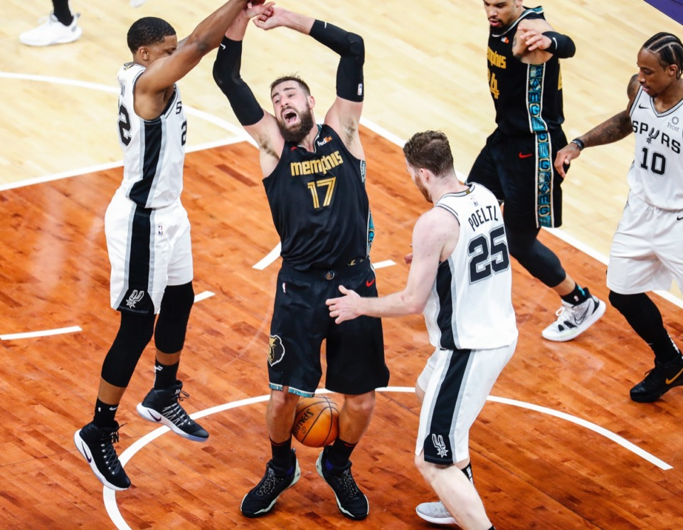 <strong>Grizzlies center Jonas Valanciunas traps the ball with his legs while San Antonio&rsquo;s Rudy Gay (left) and Jakob Poeltl (right) defend on May 19 at FedExForum.</strong> (Mark Weber/The Daily Memphian)