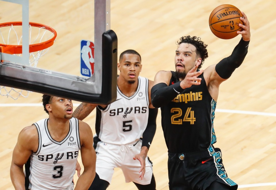 <strong>Grizzlies guard Dillon Brooks drives for a layup against San Antonio&rsquo;s Keldon Johnson (left) and Dejounte Murray (middle) on May 19 at FedExForum.</strong> (Mark Weber/The Daily Memphian)