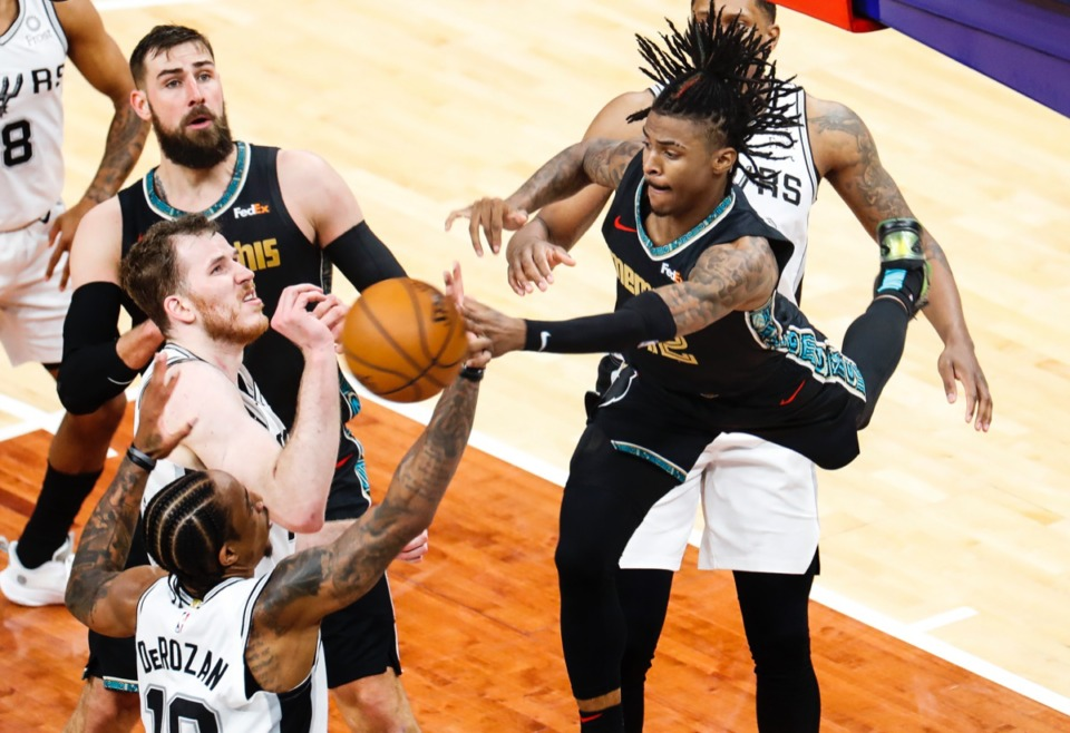 <strong>Grizzlies guard Ja Morant (right) passes over a crowd in the play-in game against San Antonio on May 19.</strong> (Mark Weber/The Daily Memphian)