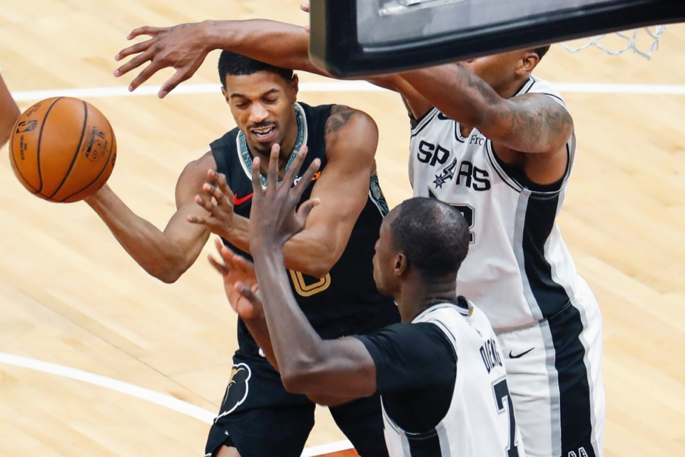 <strong>Grizzlies guard De'Anthony Melton (left) drives the lane against San Antonio on May 19 at FedExForum.</strong> (Mark Weber/The Daily Memphian)