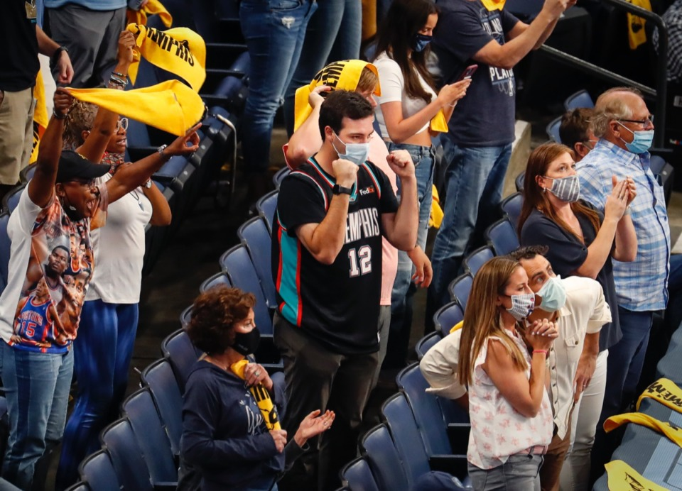 <strong>Grizzlies fans celebrate a 100-96 victory over San Antonio on Wednesday, May 19, 2021, at FedExForum.</strong> (Mark Weber/The Daily Memphian)