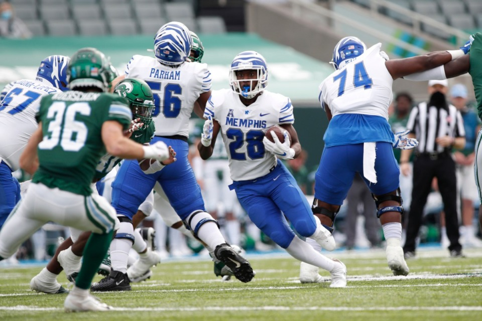 <strong>Asa Martin (28) runs against Tulane in December 2020. It was backs like Martin that eased the pain of losing Kenneth Gainwell.</strong> (Photo/Tyler Kaufman/Memphis Athletics)
