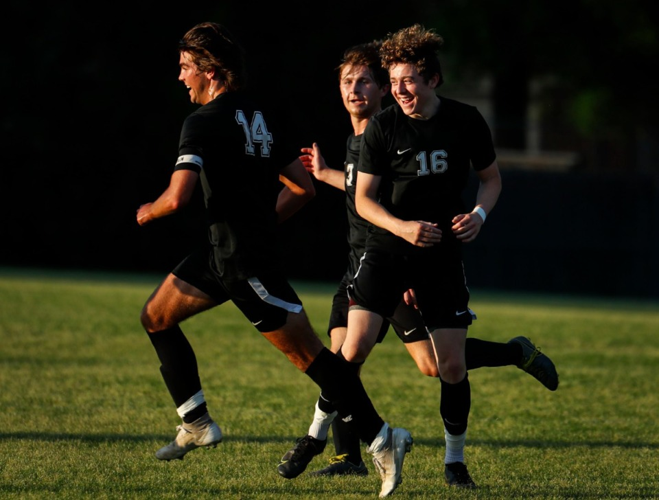 <strong>Houston midfielder Parker Humphrey (left) celebrates his goal with teammates Jackson Robertson (middle) and Cage Warmth (right) in the game against Collierville on Thursday, May 20, 2021.</strong> (Mark Weber/The Daily Memphian)