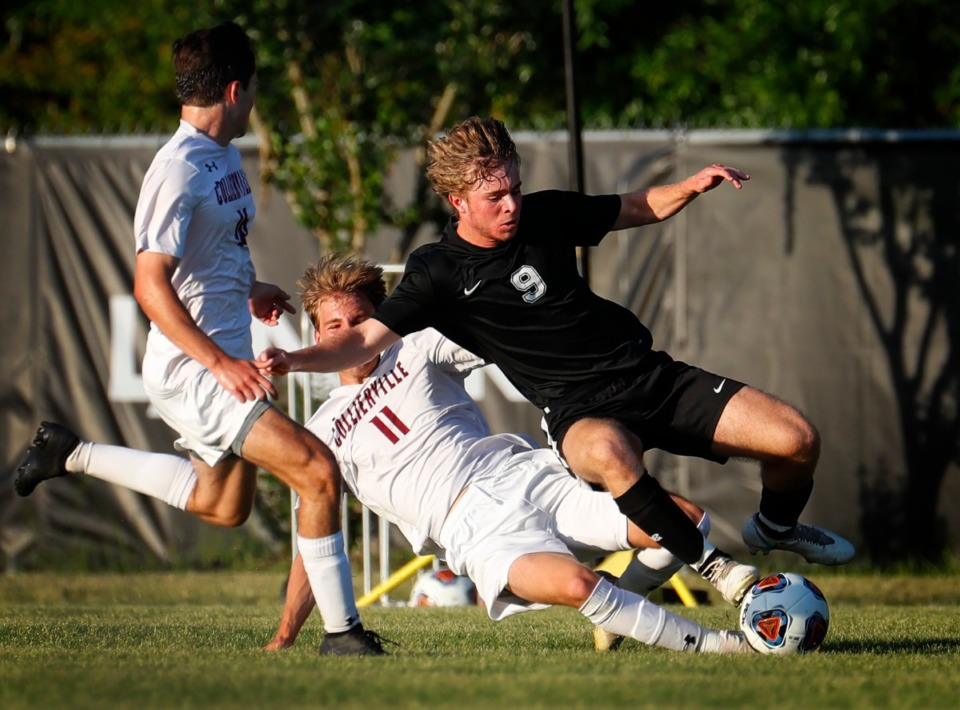 <strong>Collierville forward Reagan Ervin (middle) takes out Houston forward Noah Cooper (right) on Thursday, May 20, 2021.</strong> (Mark Weber/The Daily Memphian)