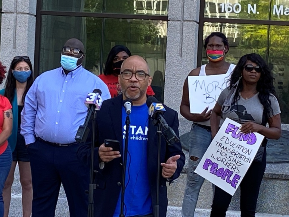<strong>Cardell Orrin of Stand for Children Tennessee (center) led a coalition of a dozen local nonprofits calling for the city and county property tax rates to stay the same to fund a&nbsp;&ldquo;moral agenda&rdquo; of items the groups favor.</strong> (Bill Dries/The Daily Memphian)