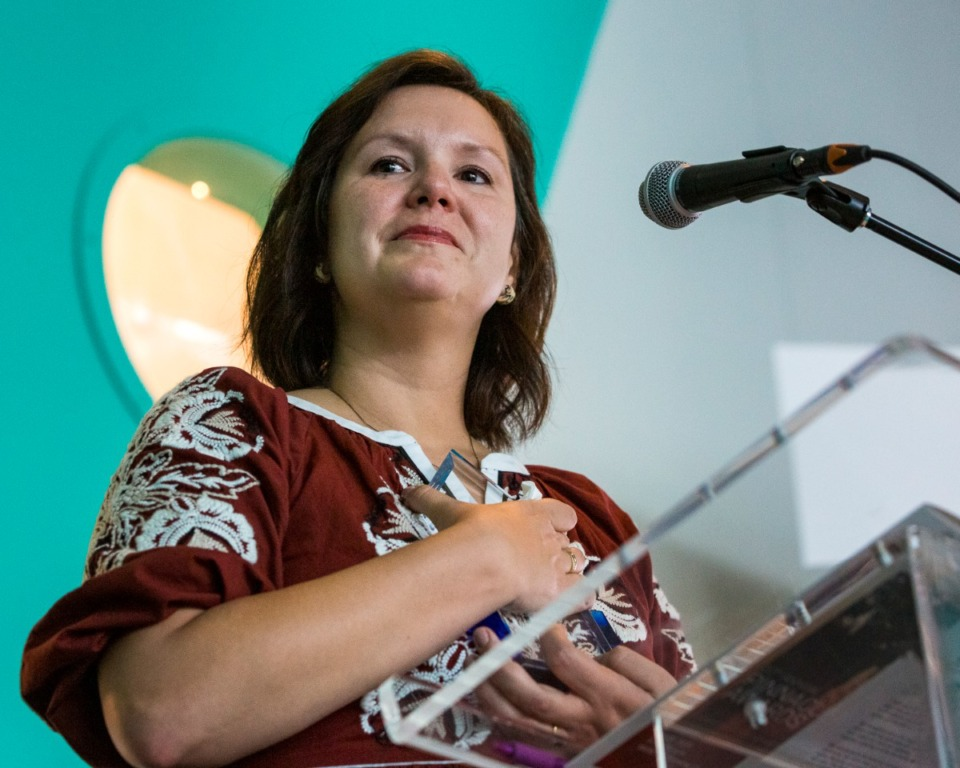<strong>Olivia Wilmot-Pacello accepts the 2020 Community Impact Award for her late husband, Tommy Pacello, during the 20th annual Pinnacle Awards Thursday,&nbsp; on May 20.</strong> (Ziggy Mack/Special to the Daily Memphian)