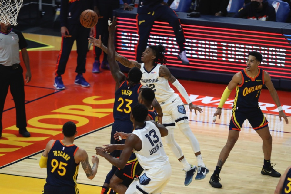<strong>Grizzlies guard Ja Morant (12) shoots against Golden State&rsquo;s Draymond Green (23) during the Western Conference play-in game in San Francisco, Friday, May 21, 2021.</strong> (Jed Jacobsohn/AP)
