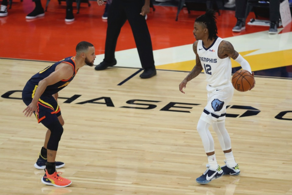 <strong>Grizzlies guard Ja Morant, right, drives against Golden State&rsquo;s Stephen Curry during the Western Conference play-in game in San Francisco, Friday, May 21, 2021.</strong> (Jed Jacobsohn/AP)