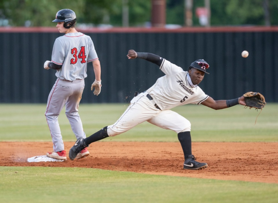<strong>Houston shortstop Pierre Seals (5) isn&rsquo;t able to grab a drive and tag Brighton High's Colton Bryant (34) at Houston High School Friday, May 21, 2021.</strong> (Greg Campbell/Special to The Daily Memphian)